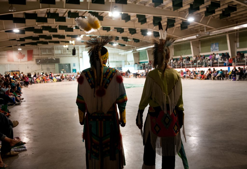 Trevor Penner (right) waits with Josh Matwiy to be initiated into pow wow, after a two-year time of learning and preparation.
