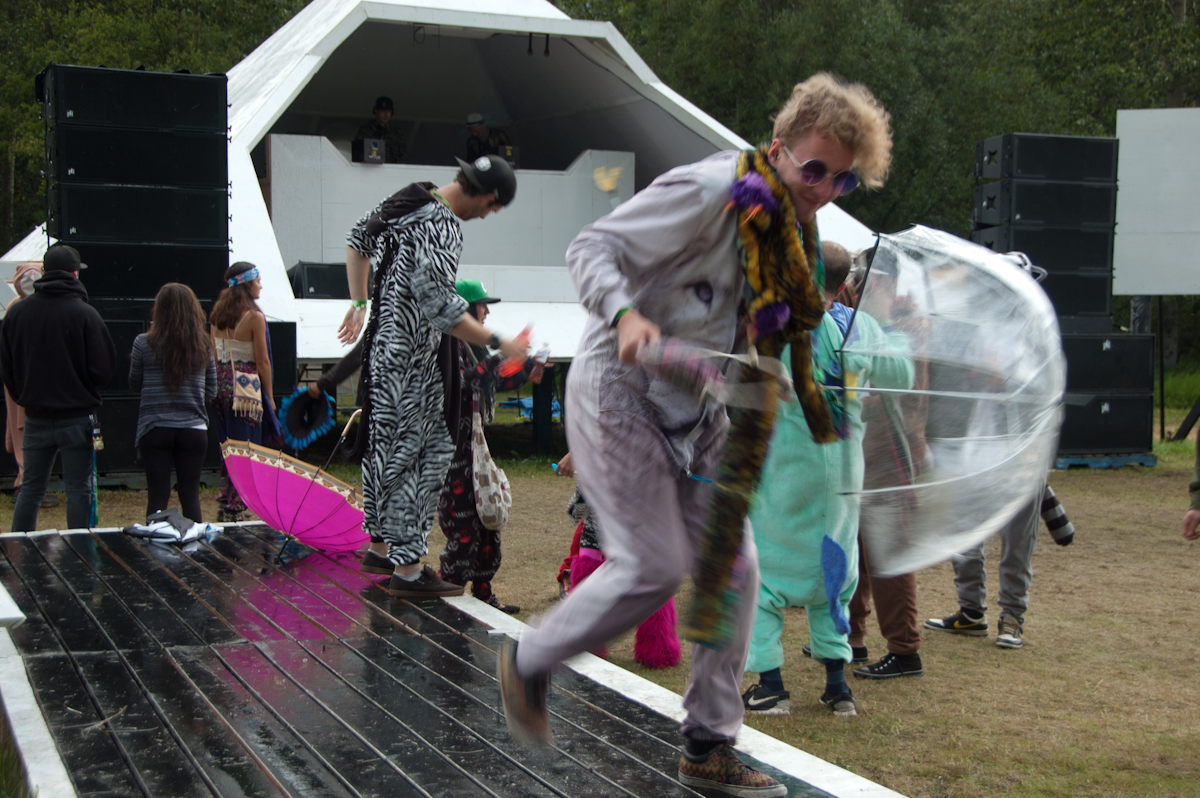 Psychedelic white lion dances at the main stage.